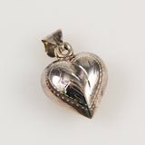 Victorian puffy heat charm sterling silver