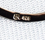 Marked 925 and logo on sterling hoop earrings