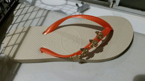 pretty tan and orange flip flops with gold butterflies charms