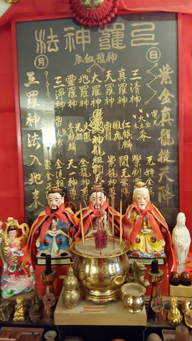 taoist with red incense