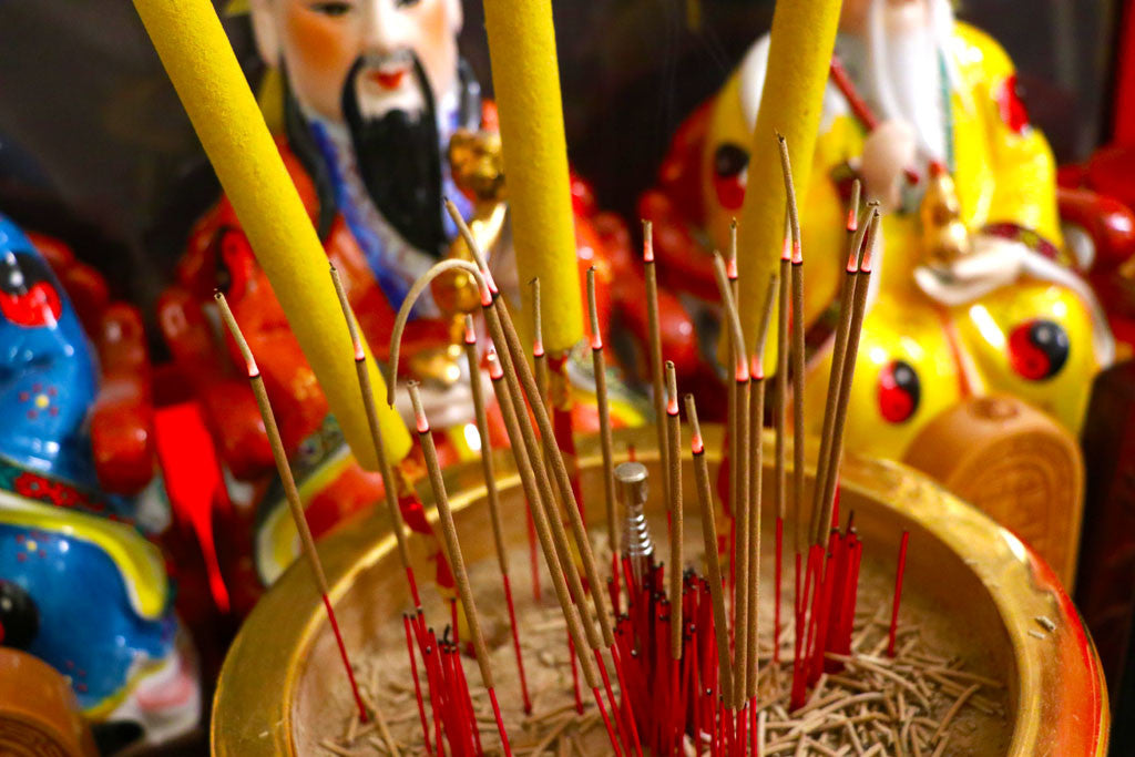 Burning incense at Taoist altar