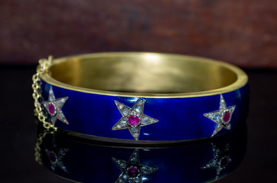 ANTIQUE ENAMELED HEAVY 18K GOLD BANGLE WITH DIAMONDS AND RUBY
