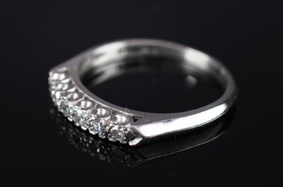 VINTAGE PLATINUM AND SINGLE CUT DIAMOND HALF BAND