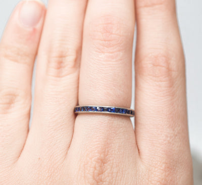 ART DECO PLATINUM AND NATURAL SAPPHIRE ETERNITY BAND