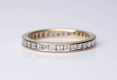TIFFANY CARRE CUT DIAMOND ETERNITY BAND IN YELLOW GOLD