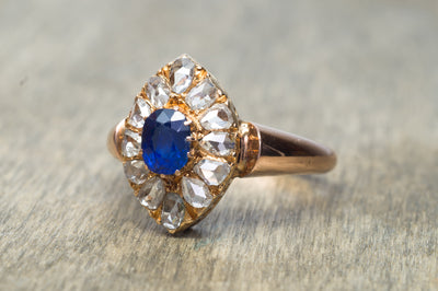 ROSE CUT DIAMOND HALO AND NATURAL SAPPHIRE RING