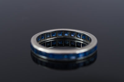 VINTAGE SAPPHIRE ETERNITY RING IN PLATINUM