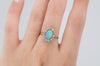 VINTAGE OPAL AND OLD MINE CUT DIAMOND HALO RING