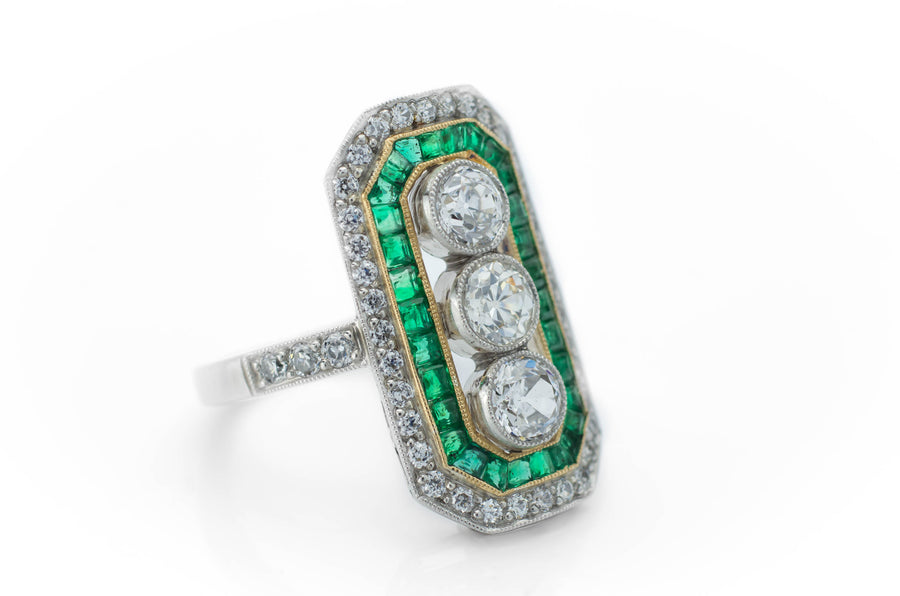 THREE STONE DIAMOND AND EMERALD RING