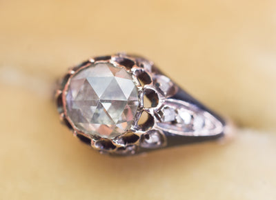 ANTIQUE ROSE CUT DIAMOND IN ENAMELED GOLD SETTING