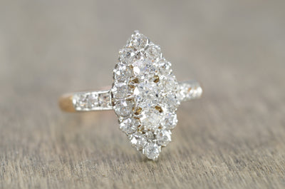 1CTW  ANTIQUE PLATINUM AND GOLD FRENCH NAVETTE DIAMOND RING