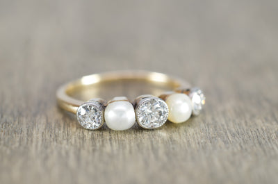 0.55CT TRANSITIONAL CUT DIAMOND AND PEARL BAND