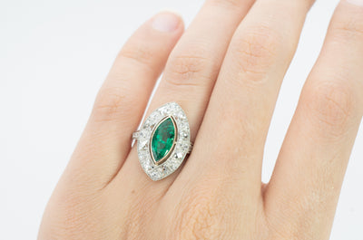 MARQUISE EMERALD ON FRENCH CUT DIAMOND HALO