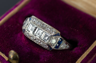 THREE STONE CARRE CUT AND SAPPHIRE ART DECO RING