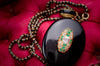 ANTIQUE BLACK ENAMEL LOCKET AND DIAMOND WITH EMERALD - SinCityFinds Jewelry