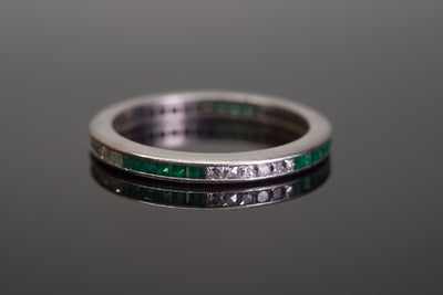 ART DECO FRENCH CUT DIAMOND AND NATURAL EMERALD ETERNITY BAND