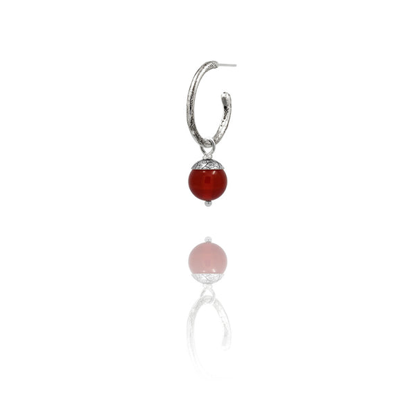sterling silver textured twig hoop earrings with interchangeable red acorn drops. Handmade in Salisbury, Wiltshire.