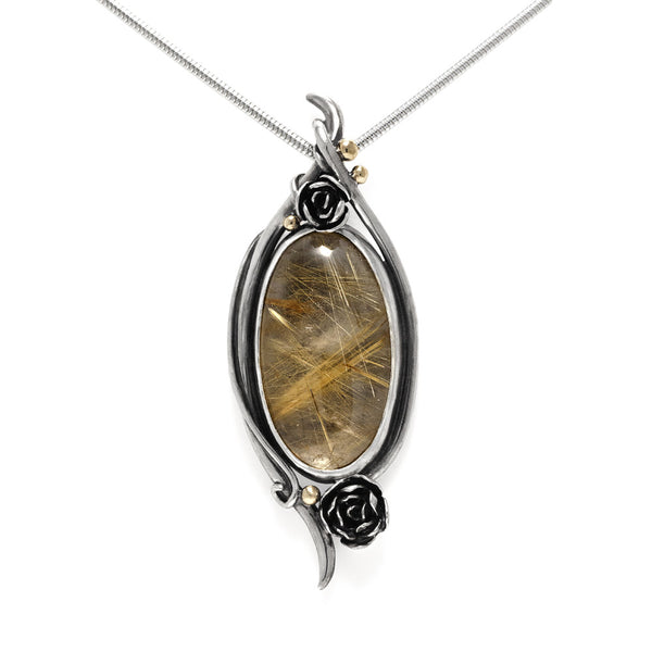 Sterling silver and 9ct gold rose pendant with rutilated quartz