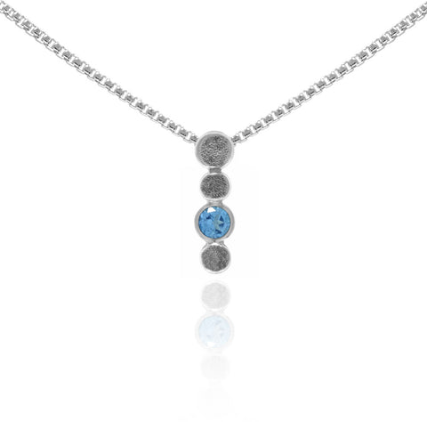 Halo drop pendant in sterling silver and blue topaz
