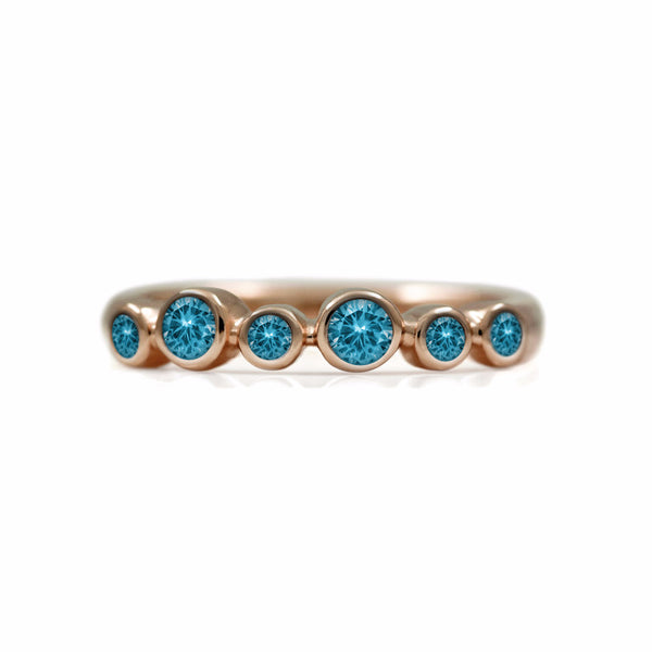 Halo half eternity ring - 9ct rose gold and blue topaz