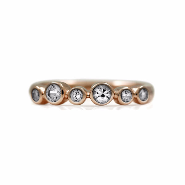 Halo half eternity ring - 9ct rose gold and white topaz