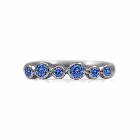 Halo half eternity ring - sterling silver and blue sapphire
