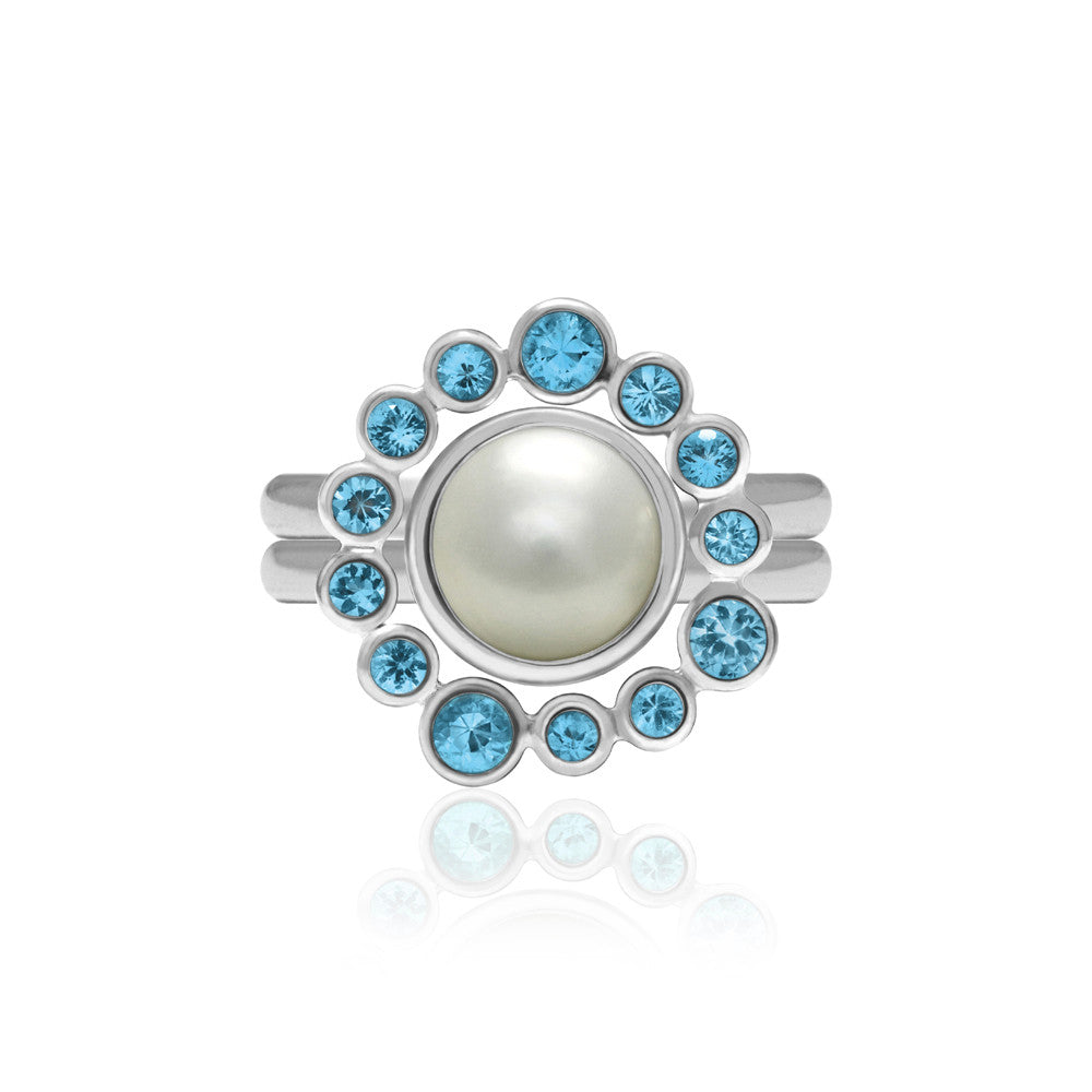 Sterling silver and blue topaz halo ring with an interlocking pearl solo ring