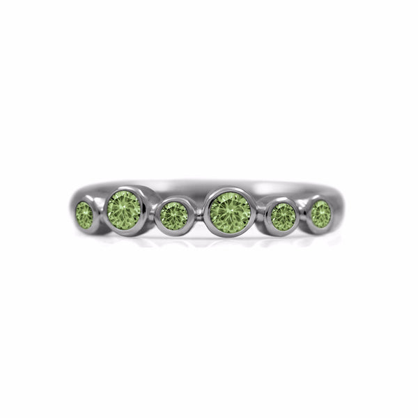 Halo half eternity ring - sterling silver and green sapphire