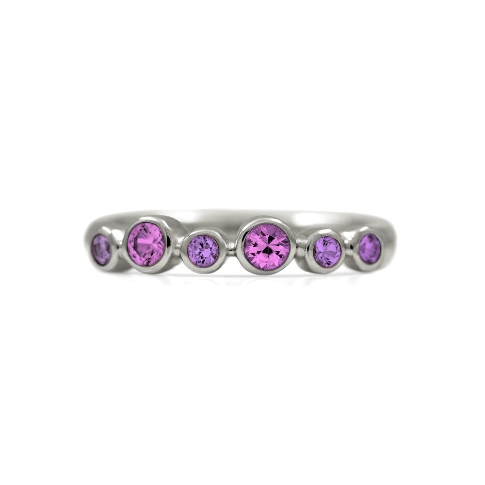 Halo half eternity ring - sterling silver and pink sapphire