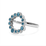 Sterling silver and blue topaz halo ring