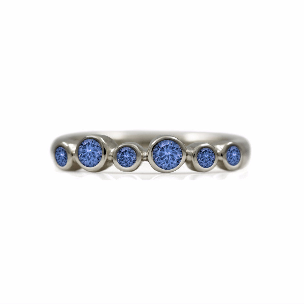Halo half eternity ring - 9ct white gold and blue sapphire