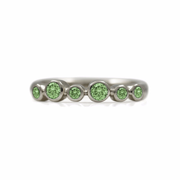 Halo half eternity ring - 9ct white gold and green sapphire