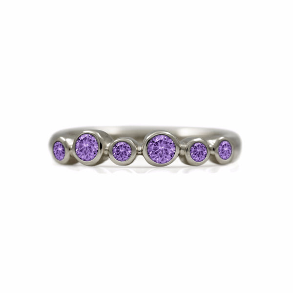 Halo half eternity ring - 9ct white gold and purple sapphire