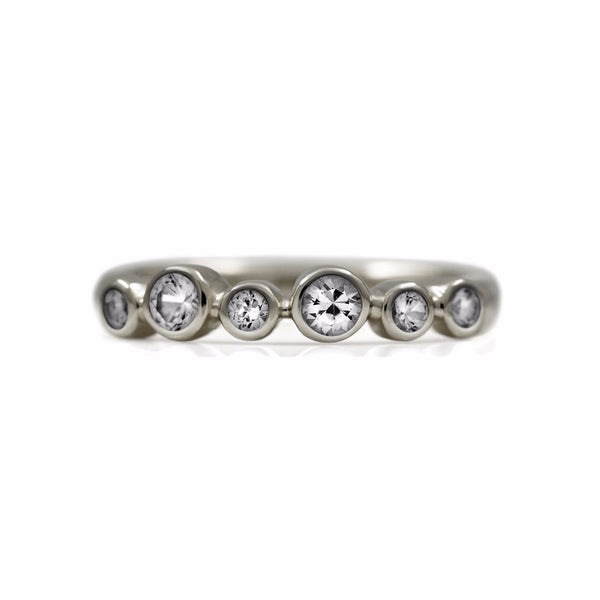 Halo half eternity ring - 9ct white gold and white topaz