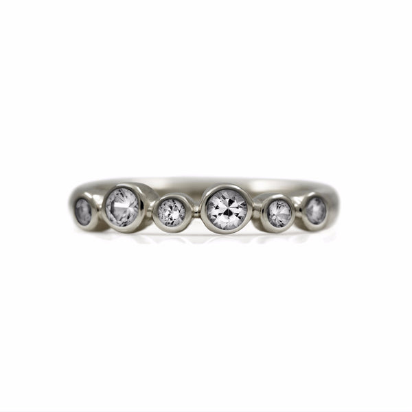 Halo half eternity ring - 9ct white gold and white sapphire