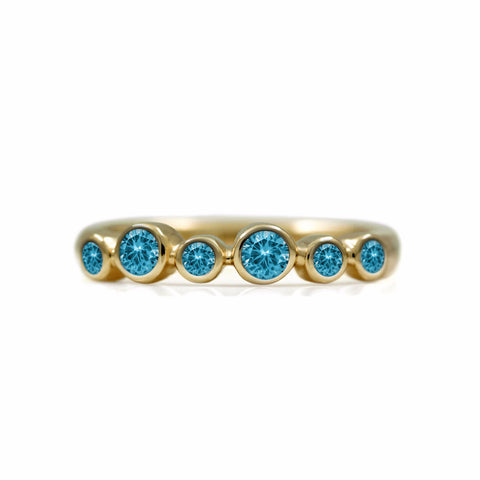 Halo half eternity ring - 9ct yellow gold and blue topaz