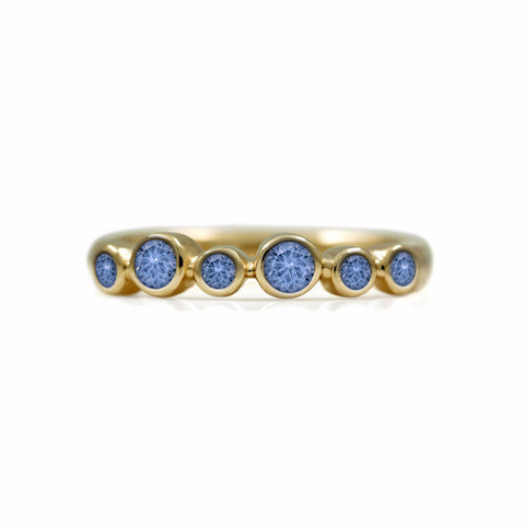 Halo eternity ring in 9ct gold and sapphire
