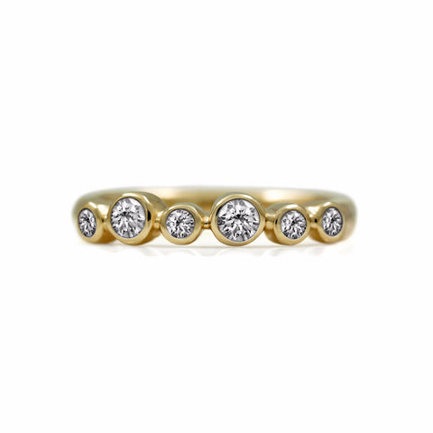 Halo diamond eternity ring in 9ct gold and 18ct gold