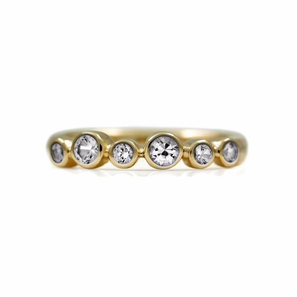 Halo half eternity ring - 9ct yellow gold and white topaz