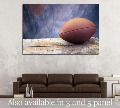Football on old ages wood table and studio tan and blue back drop №2114 Ready to Hang Canvas Print