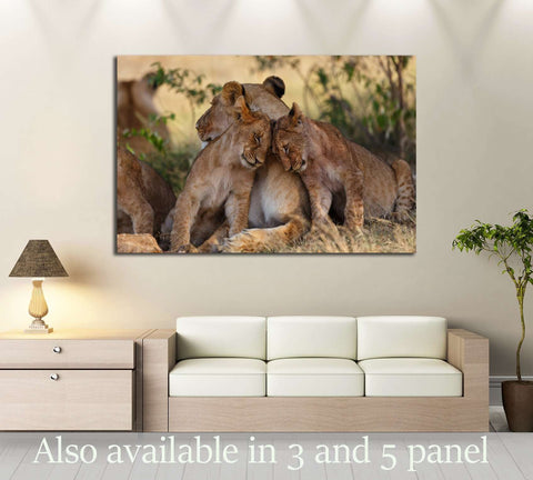 Lion cubs cuddle with mother after a good breakfast in Masai Mara, Kenya №2796 Ready to Hang Canvas Print