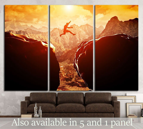 Man jumping over precipice between two rocky mountains №1373 Ready to Hang Canvas Print