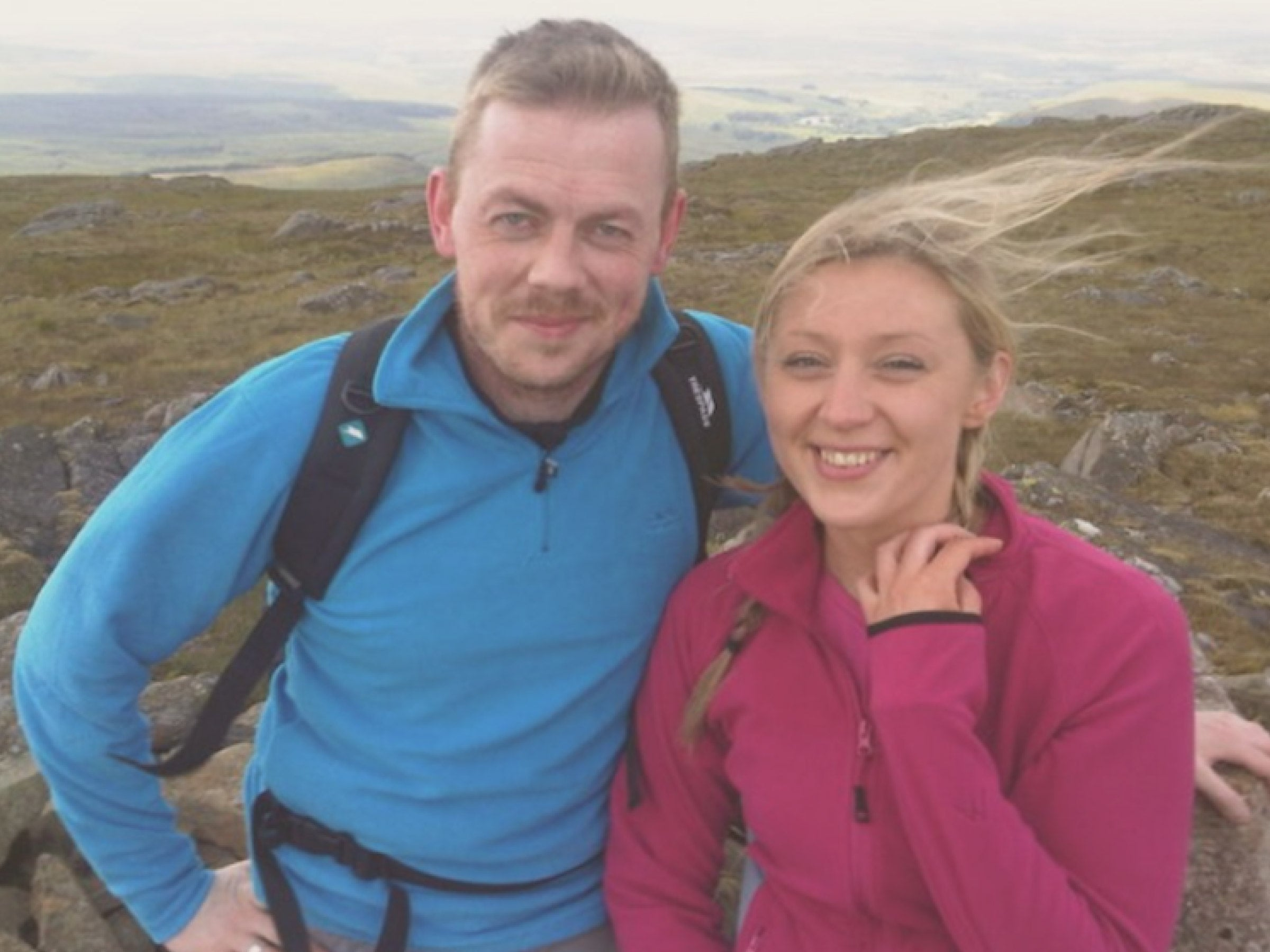 Image of Sam and Jane at the summit of a hill in Ayrshire