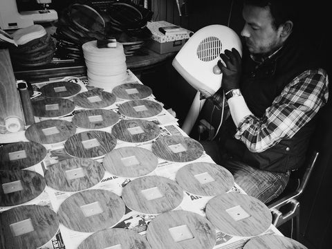 Sam Kilday making textile clocks in workshop in Ayrshire