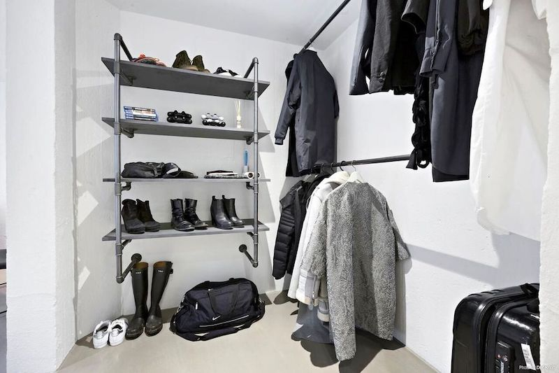 RackBuddy walk-in closet with custom rails and shelves