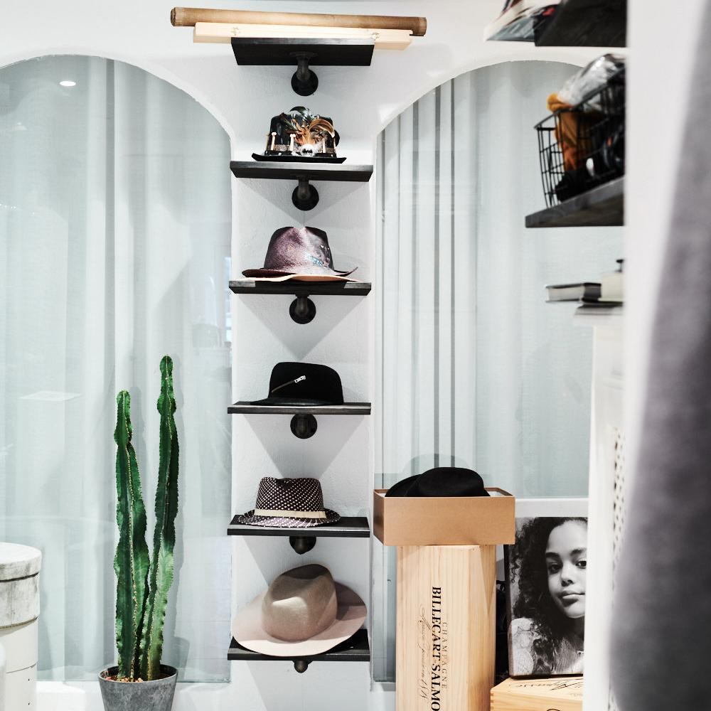 hat shelves by RackBuddy in a walk-in closet
