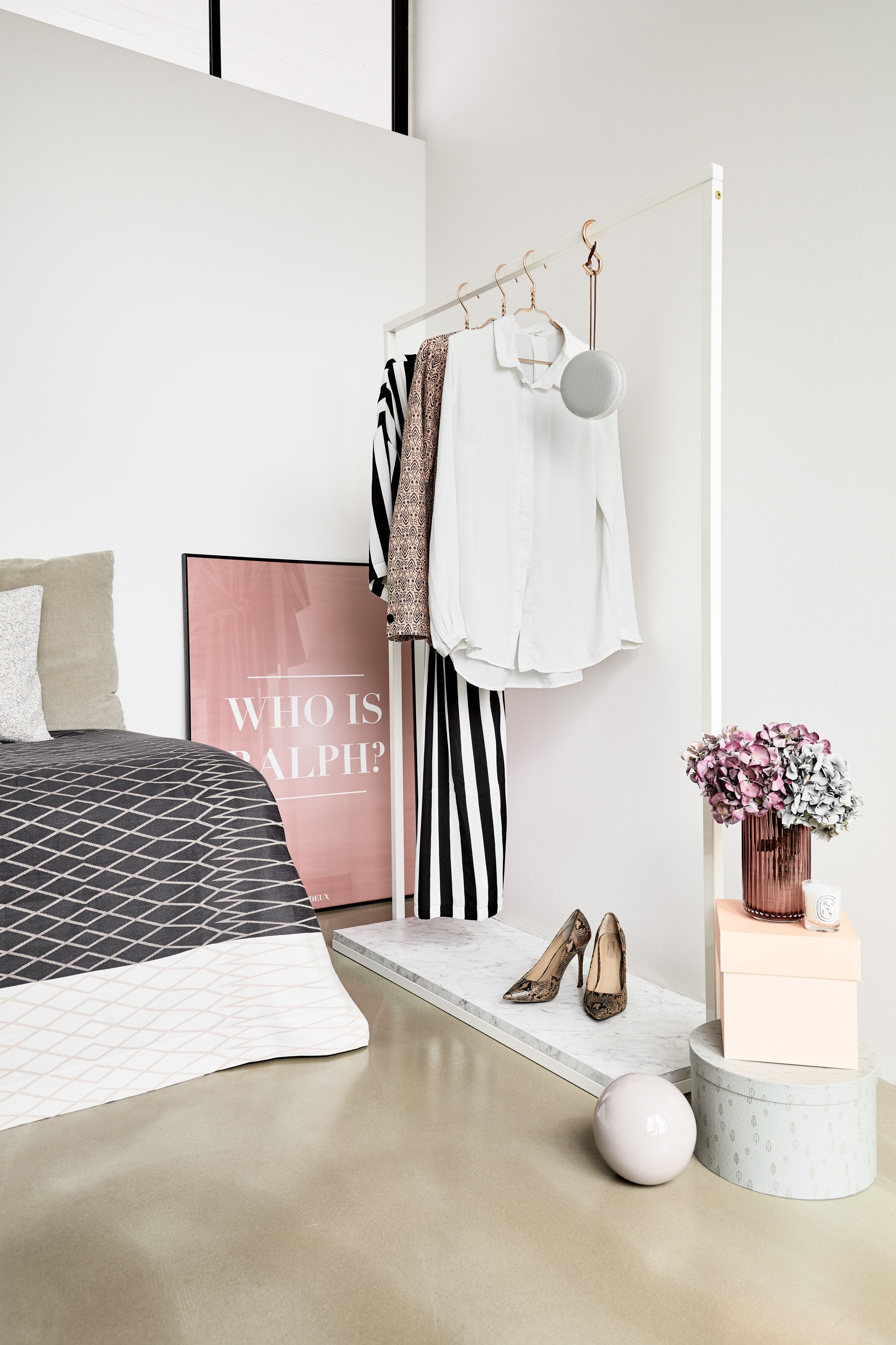 RackBuddy Mary - minimalist clothes rack made from iron in a white color