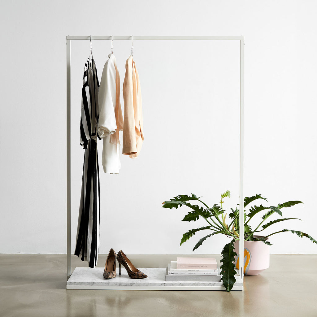 White Clothes Rack With Marble Look Bottom Shelf