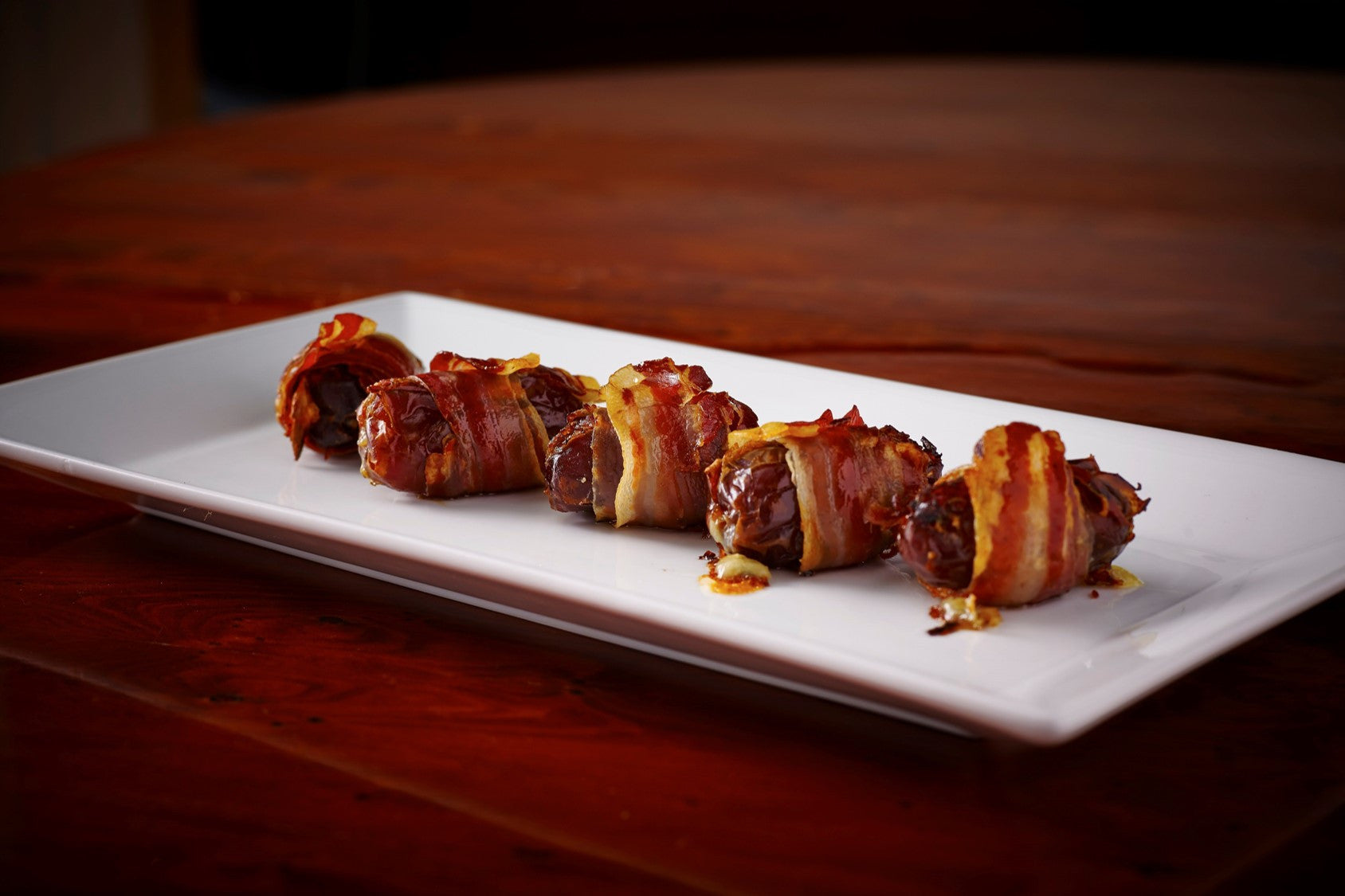 Dates stuffed with blue cheese and wrapped in Smoked Pancetta