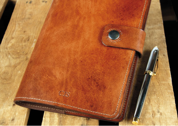 Leather bound refillable notebook